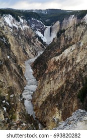 Vertical shot of Lower Falls at Yellowstone National Park in the spring.