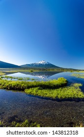 Vertical shot of Mount Bachelor being reflected in Sparks Lake near Bend, Oregon