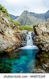 Vertical shot of one of the Fairy Pools in the Isle of Skye, Scotland. The Fairy Pools are a natural waterfall phenomenon in Glen Brittle on the Isle of Skye comprising vivid blue & green water pools.
