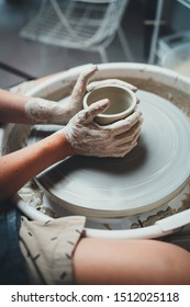 Vertical Shot of Professional Female Ceramic Artist Working in Own Pottery Studio on Pottery Wheel Makes Handcrafted Products, Creative People Handmade Design Art