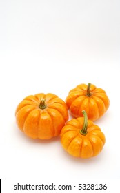 Vertical shot of Pumpkins over white background for halloween