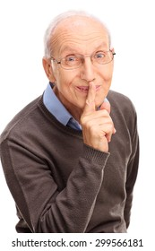 Vertical shot of a senior gentleman holding finger on his lips and looking at the camera isolated on white background