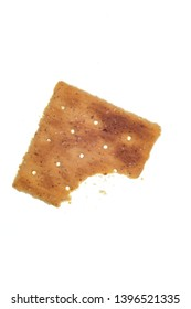 Vertical shot of a single whole-wheat cracker with one bite gone.  Isolated on white.
