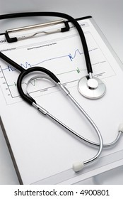 Vertical shot of Stethoscope on clipboard over blood pressure graph printout