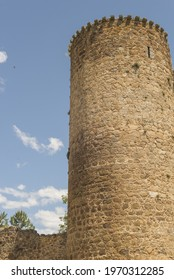 A vertical shot of the tower of Barco Avila Castilla la Mancha in Spain under a cloudy sky