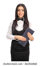 Vertical shot of a young waitress holding a menu and looking at the camera isolated on white background