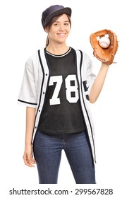 Vertical shot of a young woman in a baseball jersey holding a baseball and looking at the camera isolated on white background