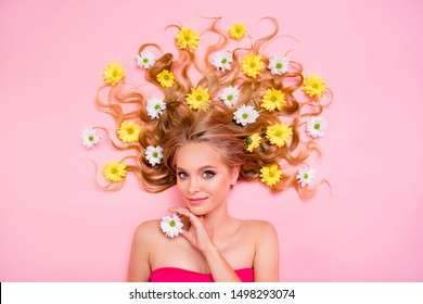 Vertical side profile top above high angle view photo beautiful she her lady lying down among flowers long curly wavy hair one arms floral concept skin treatment overjoyed isolated pink background