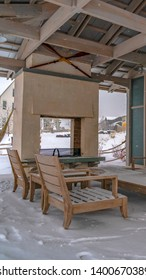 Vertical Snow covered patio of a clubhouse in Daybreak Utah