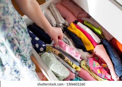 Vertical storage of clothing. Clothing folded for vertical storage in the linen drawer.
