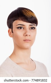 Vertical studio portrait. Beautiful young woman with trendy short pixie hairstyle on white background.