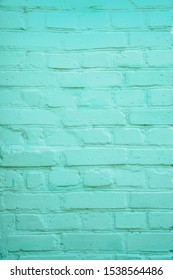 Vertical teal turquoise or aqua mint green brick wall background.