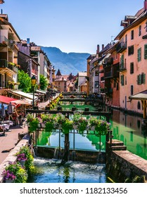 Vertical Thiou river canal view and street view in old Annecy town in France with flowered lock