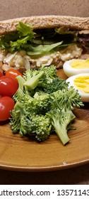vertical tuna salad sandwich egg broccoli tomato plated