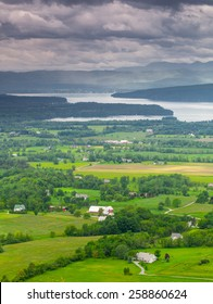 Vertical Vermont Countryside scene looking towards Lake Champlain and the Adirondack Mountains.  The shot was taken from Mount Philo State Park