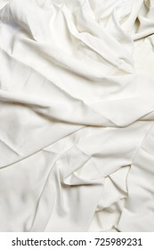 Vertical version of textured white crumpled sheets