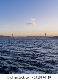 Vertical view of the Bosphorus in Istanbul, Turkey with the 15th July Martyrs Bridge and the skyline of the European side at sunrise