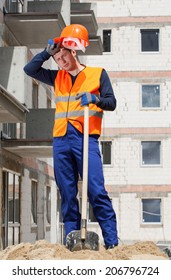 Vertical view of a exhausted construction worker