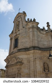 Vertical View of the Facade of the Exterior of the Church of Purgatory on Blue Sky Background. Matera, South of Italy