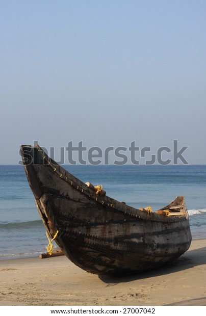 vertical view of fishing boat at the ocean coast