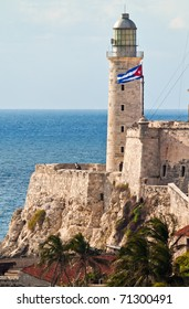 Vertical view of the fortress of El Morro in Havana with a waving cuban flag