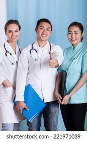 Vertical view of happy and diverse doctors