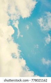 The vertical view of light blue sky with white clouds for background or texture. Copy space