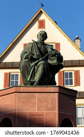 Vertical view of monument of the famous astronomer and mathematician Johannes Kepler, erected in Weil der Stadt in 1870, traditional German architecture in the background  - Shutterstock ID 1769041436