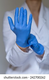Vertical view of nurse wearing protective gloves