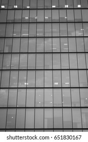 Vertical view of office building windows front facade in Santiago, Chile. Black and white photography