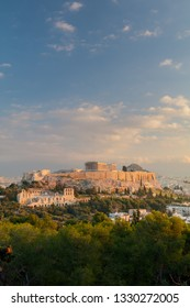 Vertical view on the Acropolis in Athens at sunrise. Scenic travel background with dramatic clouds. Greece