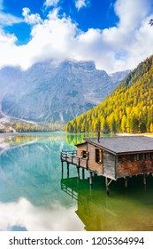 Vertical view of Prags lake, hut and Dolomites in autumn, Trentino Alto Adige, Italy