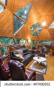 Vertical view of the rustic living room of an energy efficient custom-designed geodesic dome house.