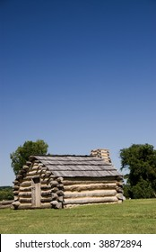 Vertical view of sky and soldier's hut in Valley Forge National Park, with room for copy or text