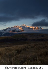 Vertical view of snowcapped Wilson Peak in Colorado's San Juan Mountains range at sunrise, San Miguel County