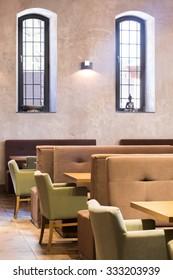 Vertical view of stylish beige restaurant interior