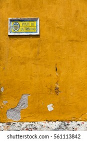 Vertical view of the Trinidad Plaza street sign in the Getsemani neighborhood in Cartagena, Colombia