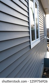 vertical view of vinyl siding on new residential home