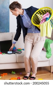 Vertical view of a young businesswoman doing the housework