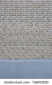 Vertical White Brick Wall with Blue bottom space.