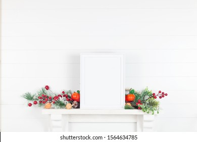 Vertical White Frame Mockup for an Autumn Holiday - an Empty Frame on a Mantelpiece With Autumn Leaves