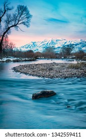 Vertical winter dawn scene along the Provo River, Utah, USA.