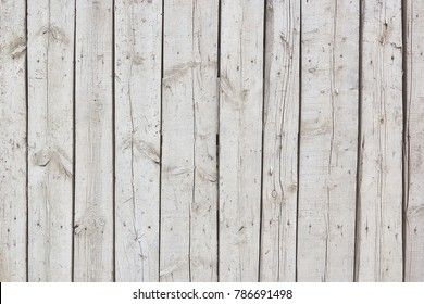 Vertical wooden gray boards. Blank background of wooden panels. Texture of a rough surface of a rustic wooden wooden fence.