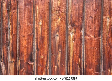 Vertically tiled stained wood wall texture background.