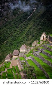 Verticle shot of terraced houses and fields of Machu Picchu