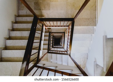 Vertigo concept, fear of heights inside a staircase of a building.
