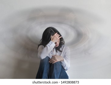 Vertigo illness with dizziness in woman patient feeling dizzy, faint with spinning movement inside head from benign paroxysmal positional vertigo (BPPV), migraine headaches or hearing loss problem