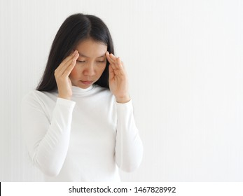 vertigo illness and sick building syndrome or SBS, brain atrophy in asian woman, She use hand touching head and felling headache dizzy sense use for health care concept.