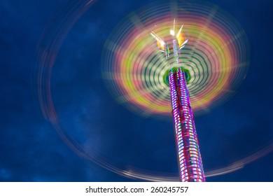 Vertigo swing ride at the Oregon State Fair at dusk