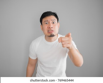 Very angry aggressive Asian man portrait in white t-shirt.